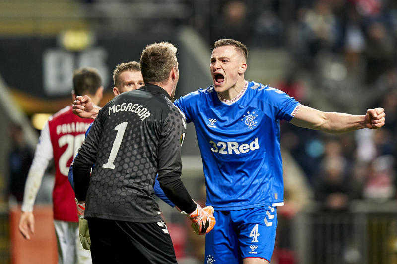 BRAGA, PORTUGAL - FEBRUARY 26: George Edmundson and Allan McGregor of Rangers FC celebrate the victory at the end of the UEFA Europa League round of 32 second leg match between Sporting Club Braga and Rangers FC at Estadio Municipal de Braga on February 26, 2020 in Braga, Portugal. (Photo by Jose Manuel Alvarez/Quality Sport Images/Getty Images)