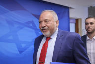 """Israeli Finance Minister Avigdor Lieberman arrives for the first weekly cabinet meeting of the new government in Jerusalem, Sunday, June 20, 2021. Prime Minister Naftali Bennett opened his first Cabinet meeting on Sunday since swearing in his new coalition government with a condemnation of the newly elected Iranian president, whom he called """"the hangman of Tehran."""" (Emmanuel Dunand/Pool Photo via AP)"""