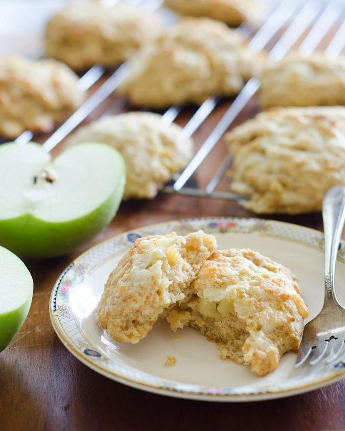 """<p>Scones are typically served for breakfast, but this savory cheese and apple version works surprising well alongside a bowl of soup. Serve it up for lunch on a chilly fall day.</p><p><a href=""""https://www.thepioneerwoman.com/food-cooking/recipes/a80241/apple-cheddar-scones/"""" rel=""""nofollow noopener"""" target=""""_blank"""" data-ylk=""""slk:Get the recipe."""" class=""""link rapid-noclick-resp""""><strong>Get the recipe.</strong></a></p>"""