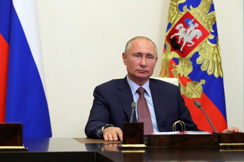 Putin urges Russians to vote for changes that could extend his rule