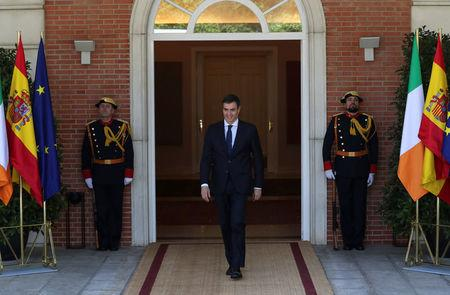Spain's Prime Minister Pedro Sanchez steps out to welcome Irish Prime Minister Leo Varadkar at the Moncloa Palace in Madrid