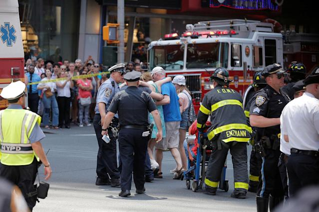 <p>First responders tend to injured pedestrians after a vehicle struck pedestrians on a sidewalk in Times Square in New York on May 18, 2017. (Lucas Jackson/Reuters) </p>