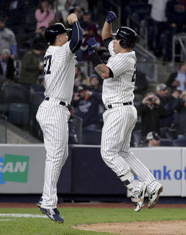 New York Yankees' Giancarlo Stanton (27) celebrates with Gary Sanchez after Sanchez hit a two-run home run against the Minnesota Twins during the seventh inning of a baseball game Tuesday, April 24, 2018, in New York. (AP Photo/Julie Jacobson)