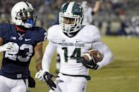 Michigan State wide receiver Tony Lippett (14) scores past Penn State cornerback Jordan Lucas (23) on a pass from quarterback Connor Cook during the second half of an NCAA college football game in State College, Pa., Saturday, Nov. 29, 2014. (AP Photo/Gene J. Puskar)
