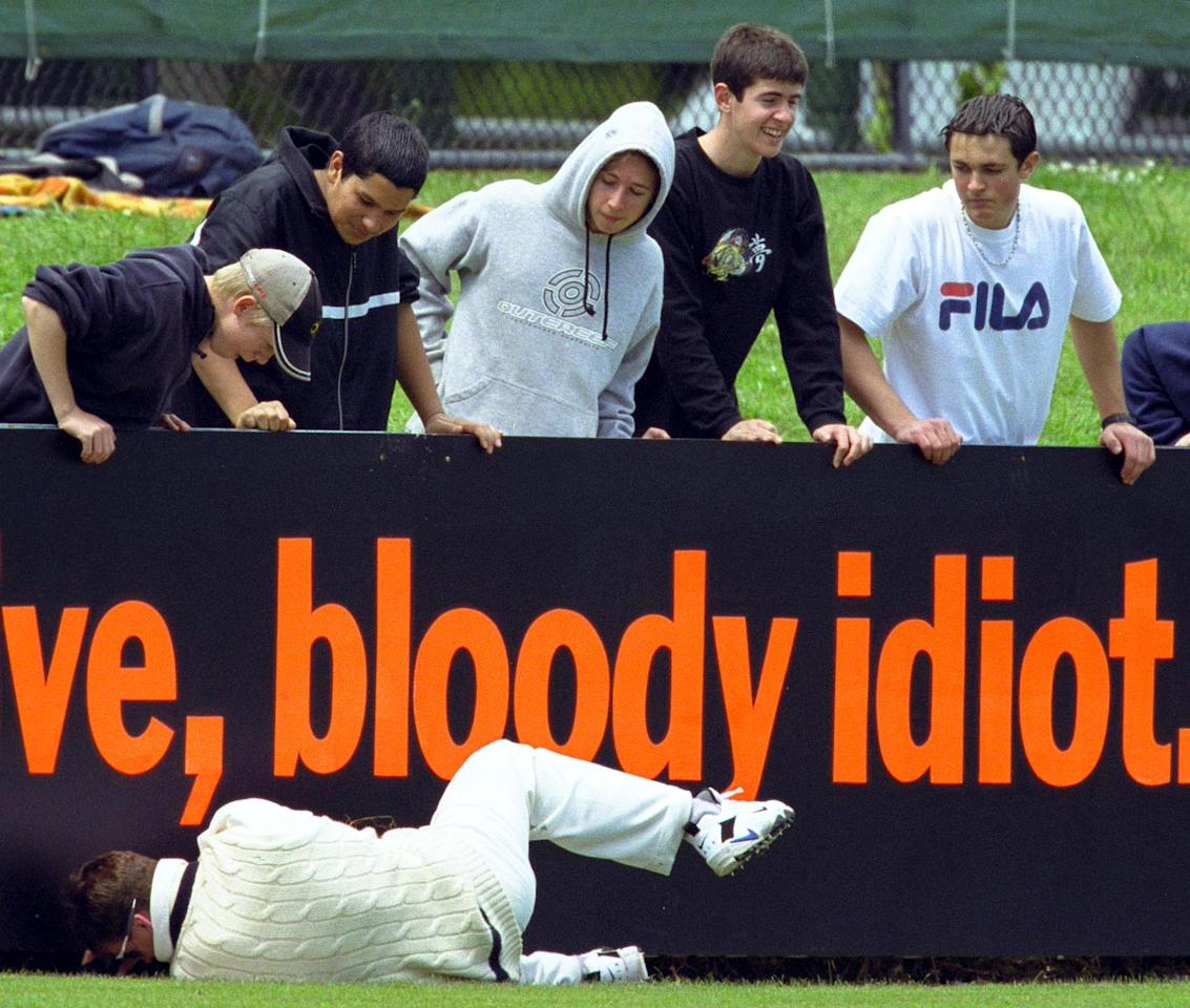 28 Oct 2000:  Graeme Vimpani of Victoria lies on the ground after crashing into the fence, fielding for the ball, whilst spectators look on, during the Pura Cup Cricket match between Victoria and New South Wales, played at Punt Rd Oval in Melbourne, Australia. Mandatory Credit: Darrin Braybrook/ALLSPORT