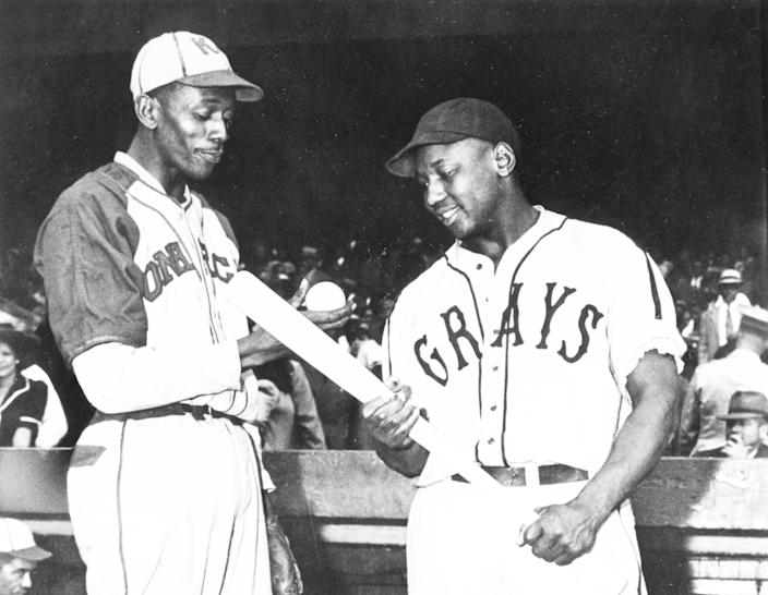 Two Negro Leagues icons: Satchel Paige (left) and Josh Gibson, shown here in 1941. (Photo by Mark Rucker/Transcendental Graphics, Getty Images)