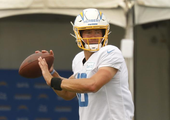 "Chargers quarterback Justin Herbert prepares to throw a during practice at the Hammett Sports Complex in Costa Mesa. <span class=""copyright"">(Al Seib / Los Angeles Times)</span>"