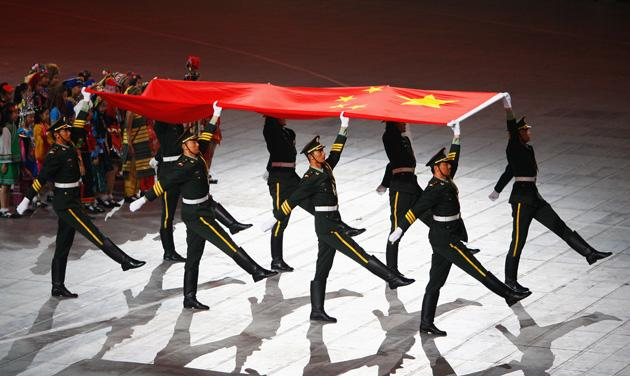 BEIJING - AUGUST 08: The Chinese national flag arrives during the Opening Ceremony for the 2008 Beijing Summer Olympics at the National Stadium on August 8, 2008 in Beijing, China.  (Photo by Cameron Spencer/Getty Images)