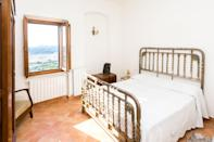 """If you're looking for a slightly more urban Airbnb that maintains a small-town feel, this two-bedroom apartment in Montepulciano will do the trick. Located right off a pedestrian street, this home has panoramic views of the Tuscan countryside from its bedrooms and front porch. We can only imagine what the sunsets look like. Amenities-wise, there are two bathrooms, a washer/dryer, and Wi-Fi. Note: There's no air-conditioning here, so plan your seasonal visit accordingly. (Temperatures in Tuscany can hit the mid-90s in July and August.) $130, Airbnb (Starting Price). <a href=""""https://www.airbnb.com/rooms/19698460"""" rel=""""nofollow noopener"""" target=""""_blank"""" data-ylk=""""slk:Get it now!"""" class=""""link rapid-noclick-resp"""">Get it now!</a>"""