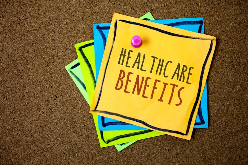 Writing note showing Healthcare Benefits. Business photo showcasing it is insurance that covers the medical expenses Papers beautiful colours messages feelings card birthday valentine