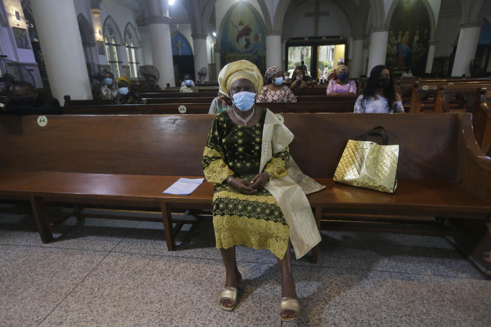 Parishioners wearing face mask to protect against coronavirus, attend a morning Christmas Mass at Holy Cross Cathedral in Lagos, Nigeria, Friday Dec. 25, 2020. Africa's top public health official says another new variant of the coronavirus appears to have emerged in Nigeria, but further investigation is needed. The discovery could add to new alarm in the pandemic after similar variants were announced in recent days in Britain and South Africa and sparked the swift return of travel restrictions. (AP Photo/Sunday Alamba)