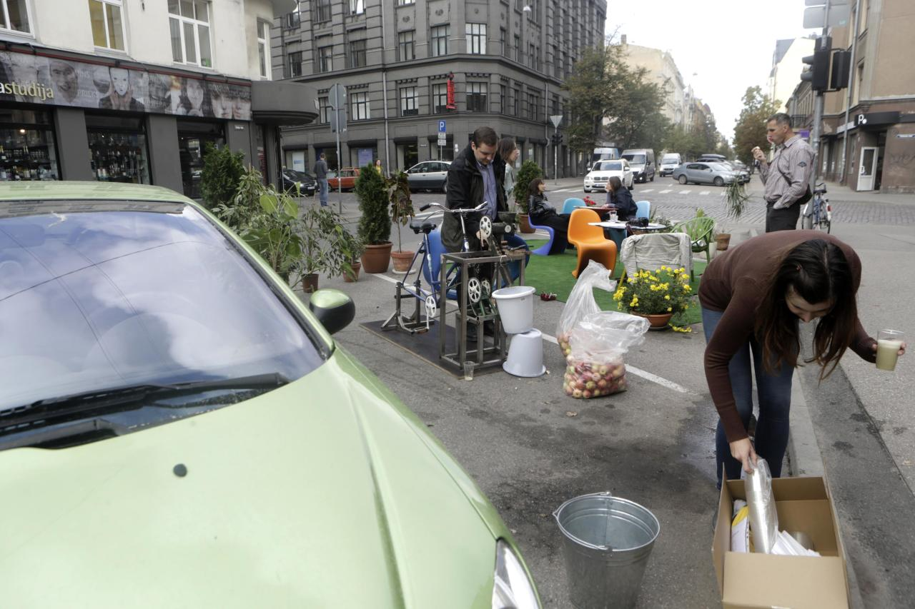People attend a PARK(ing) Day event in Riga, September 20, 2013. The event aims to transform metered parking spaces into temporary public places to call attention to the need for more urban open spaces and discuss the creation and allocation of public spaces, according to organizers. REUTERS/Ints Kalnins (LATVIA - Tags: SOCIETY)