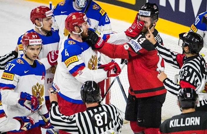 Russia's defender Vladislav Gavrikov (3rd L) and Canada´s forward Sean Couturier scuffle during the IIHF Men's World Championship Ice Hockey semi-final match (AFP Photo/Ina FASSBENDER)