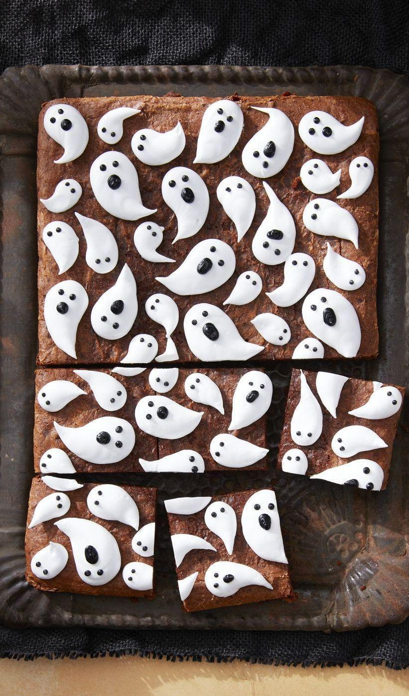 """<p>These brownies will be the most adorable item on your dessert table with their ghost decorations. </p><p><strong><em>Get the recipe at <a href=""""https://www.countryliving.com/food-drinks/a28943165/marshmallow-ghost-brownies-recipe/"""" rel=""""nofollow noopener"""" target=""""_blank"""" data-ylk=""""slk:Country Living"""" class=""""link rapid-noclick-resp"""">Country Living</a>. </em></strong></p>"""