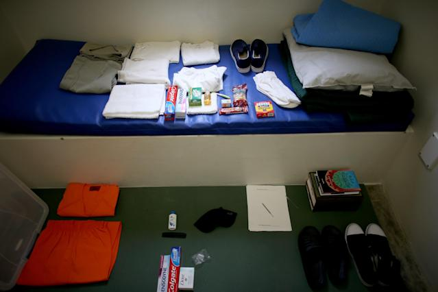 GUANTANAMO BAY, CUBA - JUNE 25: (EDITORS NOTE: Image has been reviewed by the U.S. Military prior to transmission.) A static display shows the belongings of a typical inmate in a prison cell at camp V where prisoners are housed in the single cell facility at the U.S. military prison for 'enemy combatants' on June 25, 2013 in Guantanamo Bay, Cuba. President Barack Obama has recently spoken again about closing the prison which has been used to hold prisoners from the invasion of Afghanistan and the war on terror since early 2002. (Photo by Joe Raedle/Getty Images)