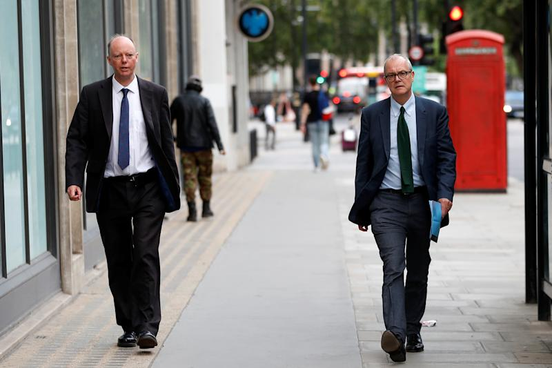 Chief Medical Officer for England Chris Whitty is seen walking alongside Chief Scientific Adviser Sir Patrick Vallance, amid the outbreak of the coronavirus disease (COVID-19), in London, Britain, September 9, 2020. REUTERS/Peter Nicholls