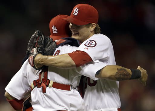St. Louis Cardinals starting pitcher Shelby Miller, right, is congratulated by catcher Yadier Molina after throwing a complete baseball game against the Colorado Rockies, Friday, May 10, 2013, in St. Louis. Miller gave up one hit in the 3-0 victory. (AP Photo/Jeff Roberson)