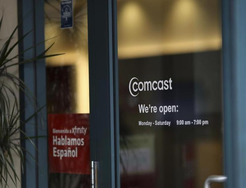 A Comcast sign is shown on the entrance to its store in San Francisco