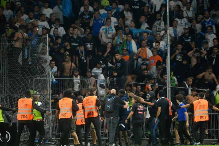 Fans in the Marseille end invade the pitch during their team's 0-0 draw with Angers in Ligue 1 on Wednesday (AFP/JEAN-FRANCOIS MONIER)