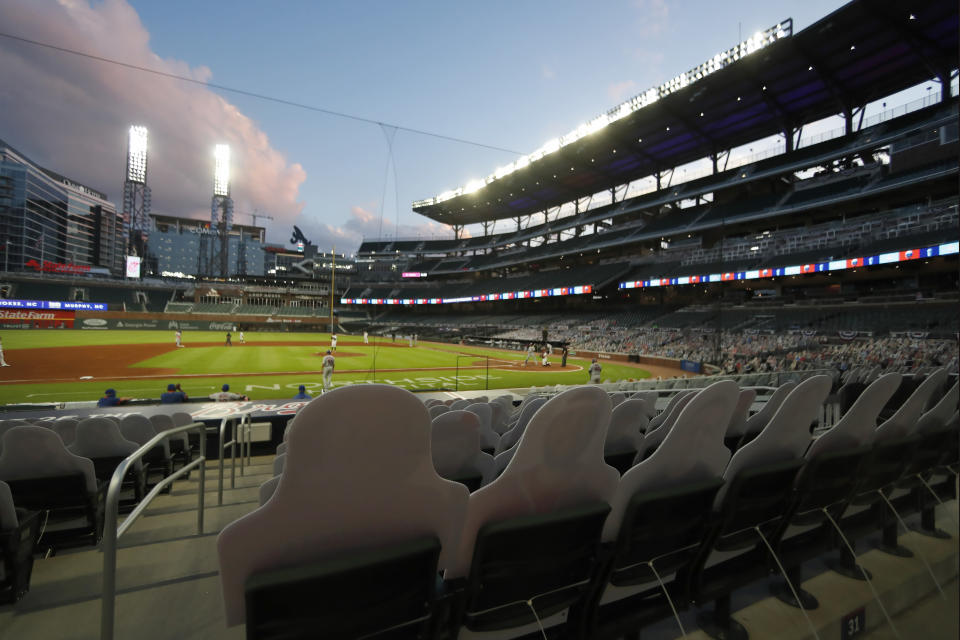 Atlanta Braves play the New York Mets with no fans in attendance at Truist Park during a baseball game Saturday, Aug. 1, 2020, in Atlanta. (AP Photo/John Bazemore)