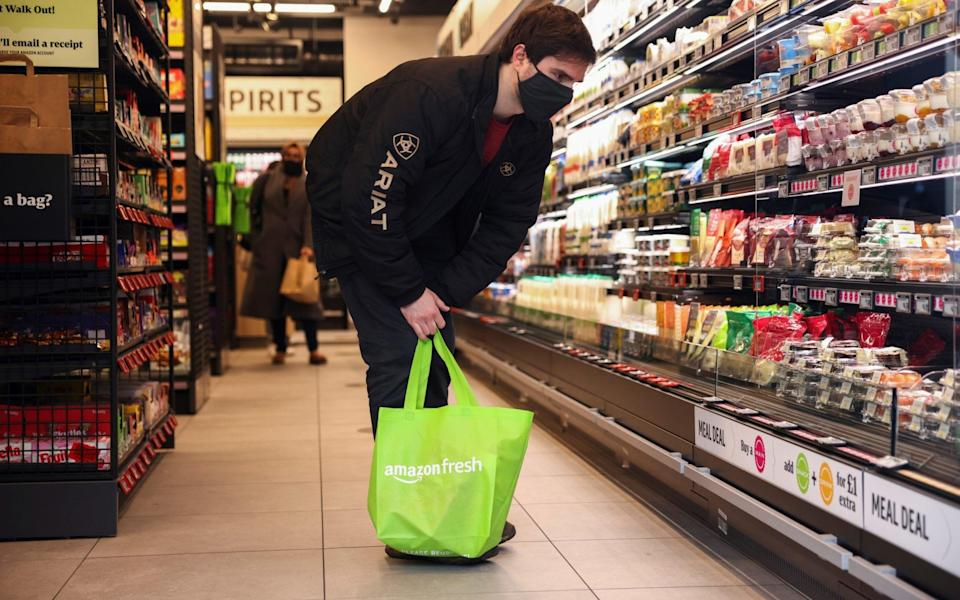 A customer looks at the products at the UK's first Amazon Fresh supermarket - HENRY NICHOLLS/REUTERS