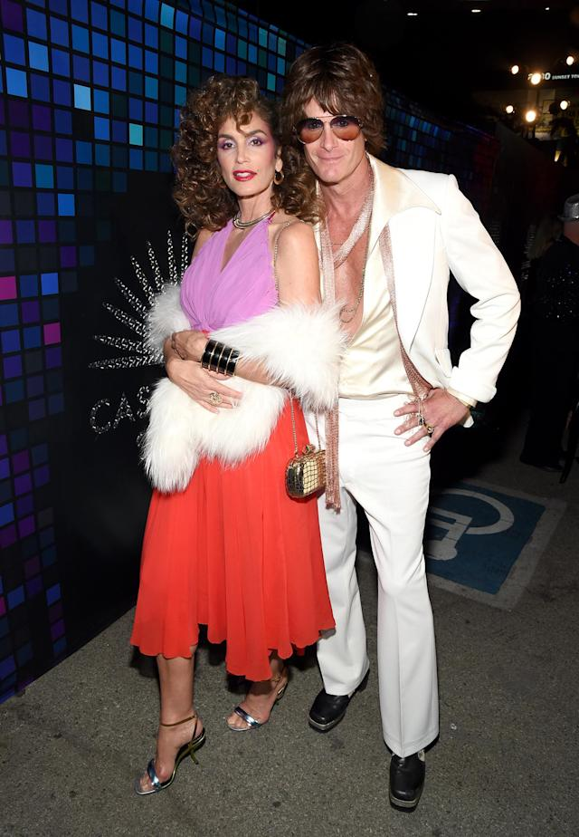 <p>The supermodel and her husband rocked some awesome '70s garb to go along with the theme of the Casamigos bash. If prom king and queen were a thing for Halloween, these two would definitely win. (Photo: Michael Kovac/Getty Images for Casamigos Tequila) </p>