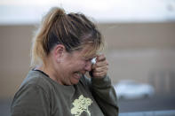Edie Hallberg cries while speaking to police outside a Walmart store where a shooting occurred earlier in the day as she looks for her missing mother Angie Englisbee, who was in the store during the attack in El Paso, Texas, Saturday, Aug. 3, 2019. Multiple people were killed and one person was in custody after a shooter went on a rampage at a shopping mall, police in the Texas border town of El Paso said. (AP Photo/Andres Leighton)
