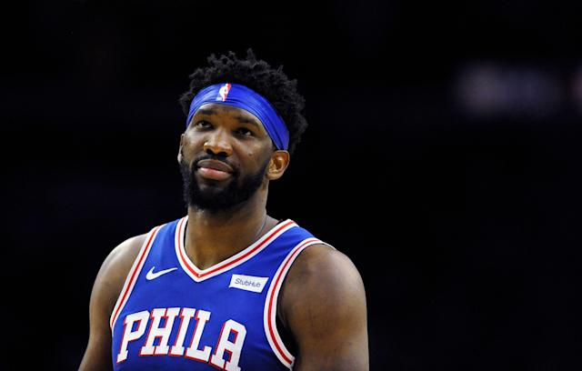 Joel Embiid and Amir Johnson were caught looking at a cell phone on the bench during the 76ers playoff loss to the Brooklyn Nets on Saturday. (AP/Michael Perez)