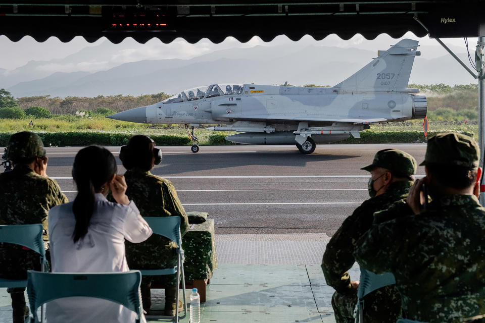 In this photo released by the Taiwan Presidential Office, a military jet taxis along a highway in Jiadong, Taiwan, Wednesday, Sept. 15, 2021. Four military aircraft landed on the highway and took off again on Wednesday as part of Taiwan's five-day Han Guang military exercise designed to prepare the island's forces for an attack by China, which claims Taiwan as part of its own territory. (Taiwan Presidential Office via AP)