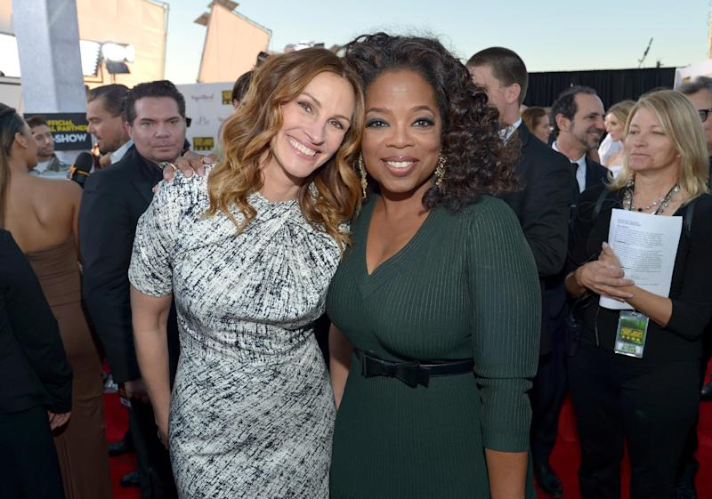 Julia Roberts, left, and Oprah Winfrey arrive at the 19th annual Critics' Choice Movie Awards at the Barker Hangar on Thursday, Jan. 16, 2014, in Santa Monica, Calif. (Photo by John Shearer/Invision/AP)