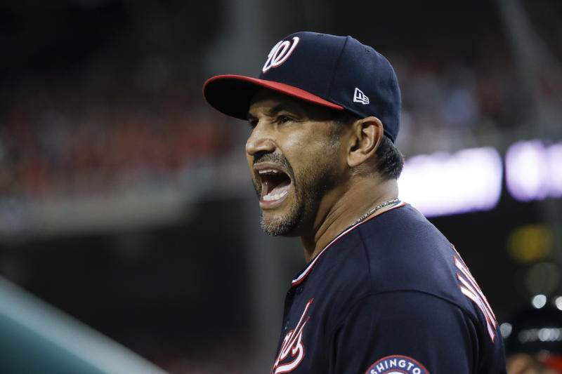 Washington Nationals manager Dave Martinez yells at the home plate umpire during the seventh inning of Game 5 of the baseball World Series against the Houston Astros Sunday, Oct. 27, 2019, in Washington. (AP Photo/Jeff Roberson)
