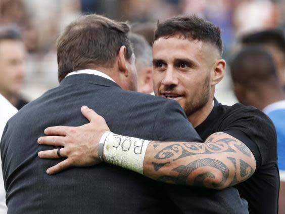 Hansen embraces TJ Perenara after the victory over Namibia (AFP via Getty)