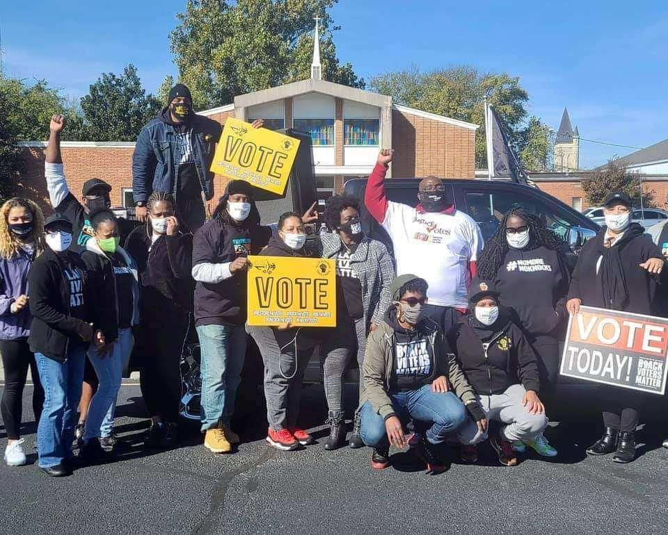 Savvy Shabazz (center, arm raised) is seen with members of the group All of Us or None Louisville during a voter registration and canvassing drive in Paducah, Kentucky, last fall. (Photo: Savvy Shabazz/All of Us or None Louisville)