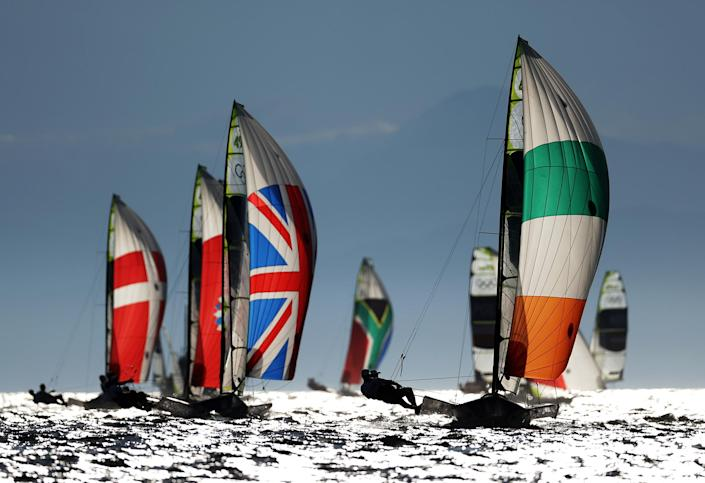 <p>Athletes from various countries compete in the men's skiff - 49er class race at Enoshima Yacht Harbour.</p>