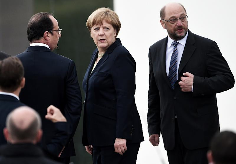 Germany's Chancellor Angela Merkel (C) will host the leaders of France, Italy and the EU in Berlin on Monday to discuss the Brexit crisis (AFP Photo/Fredercik Florin )
