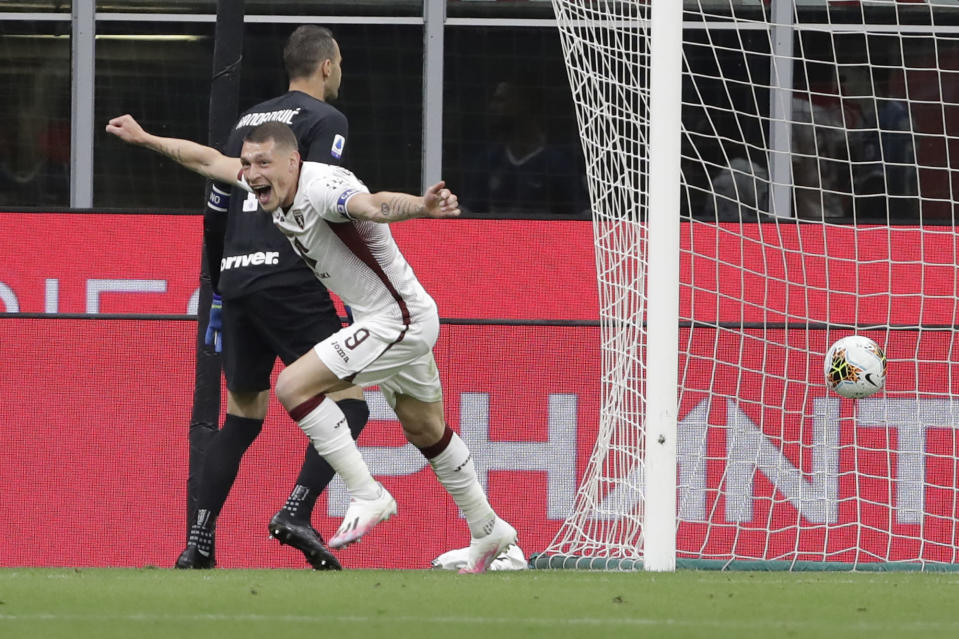 Torino's Andrea Belotti celebrates after scoring his side's opening goal during a Serie A soccer match between Inter Milan and Torino, at the San Siro stadium in Milan, Italy, Monday, July 13, 2020. (AP Photo/Luca Bruno