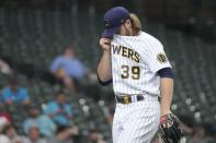 Milwaukee Brewers starting pitcher Corbin Burnes wipes his face as he walks off the moundduring the first inning of a baseball game against the Pittsburgh Pirates The Pirates scored three runs in the inning. Saturday, June 12, 2021, in Milwaukee. (AP Photo/Morry Gash)