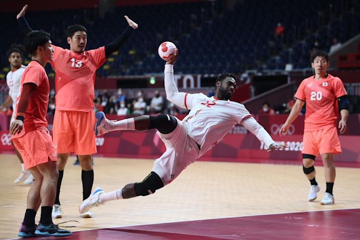 <p>Portugal's pivot Alexis Borges (2ndR) jumps to shoot past Japan's pivot Kenya Kasahara (2ndL) and Japan's right back Jin Watanabe (R) during the men's preliminary round group B handball match between Portugal and Japan of the Tokyo 2020 Olympic Games at the Yoyogi National Stadium in Tokyo on August 1, 2021. (Photo by Franck FIFE / AFP)</p>