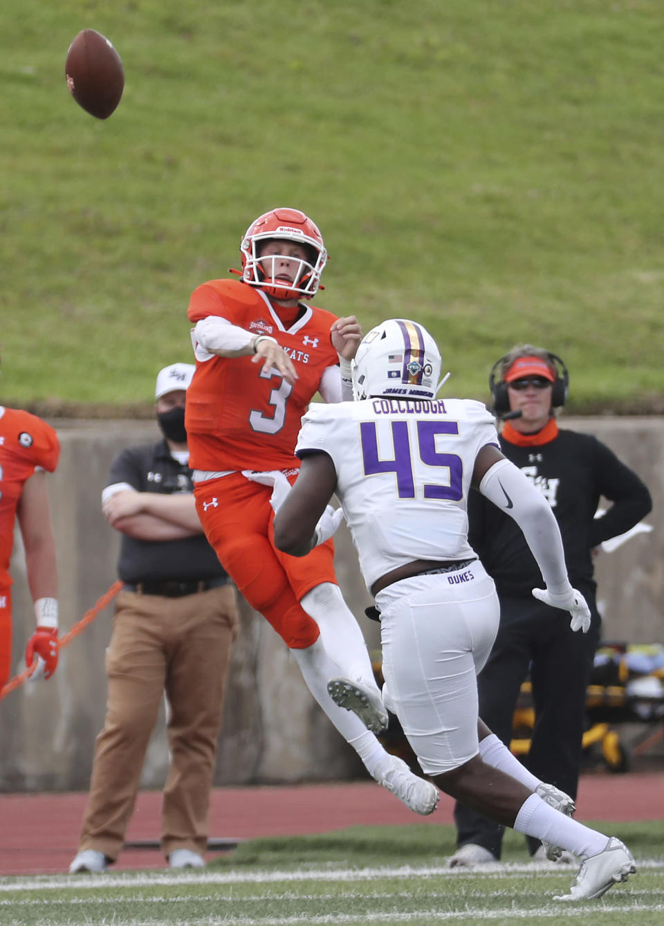Sam Houston State quarterback Eric Schmid (3) gets off a pass over James Madison defensive lineman Antonio Colclough (45) during the third quarter of a semifinal game in the NCAA college football FCS playoffs, Saturday, May 8, 2021, in Huntsville, Texas. Sam Houston came from behind to edge James Madison 38-35, for a berth in the FCS national championship game. (Brett Coomer/Houston Chronicle via AP)