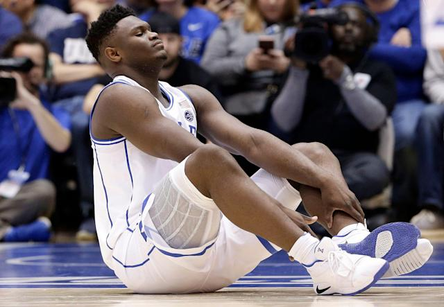 Duke's Zion Williamson sits on the floor after his shoe split Feb. 20, 2019. (AP)