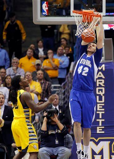 Seton Hall's Aaron Geramipoor (42) dunks in front of Marquette's Jae Crowder, left, during the first half of an NCAA college basketball game, Tuesday, Jan. 31, 2012, in Milwaukee. (AP Photo/Jeffrey Phelps)