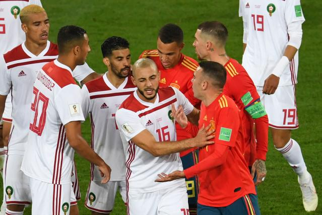 Nordin Amrabat, criticizer of VAR, argues with Iago Aspas, scorer of the goal awarded by VAR, in Spain's 2-2 draw with Morocco at the World Cup. (Getty)