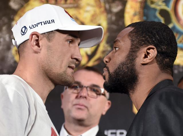 Champion Sergey Kovalev, left, and challenger Jean Pascal pose for the media. (AP)