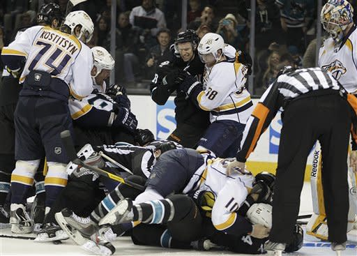 Nashville Predators and San Jose Sharks fight during the second period of an NHL hockey game Thursday, March 15, 2012, in San Jose, Calif. (AP Photo/Ben Margot)