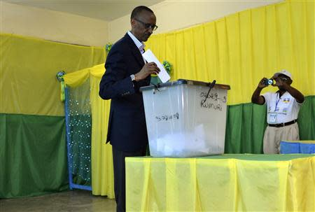 Rwanda's President Paul Kagame casts his vote during a parliamentary election in the capital Kigali