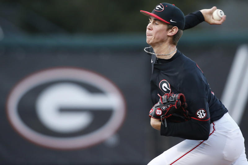 FILE - In this March 22, 2019, file photo, Georgia's Emerson Hancock throws the ball against LSU during an NCAA college baseball game in Athens, Ga. Hancock is expected to be an early selection in the Major League Baseball draft. (Joshua L. Jones/Athens Banner-Herald via AP, File)