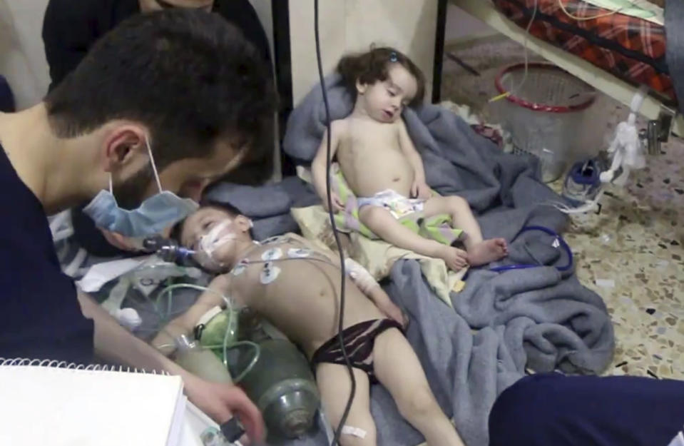<p>This image made from video released by the Syrian Civil Defense White Helmets, which has been authenticated based on its contents and other AP reporting, shows medical workers treating toddlers following an alleged poison gas attack in the opposition-held town of Douma, in eastern Ghouta, near Damascus, Syria, Sunday, April. 8, 2018. (Photo: Syrian Civil Defense White Helmets via AP) </p>