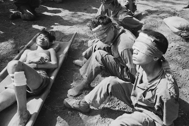 <p>Blindfolded Vietnamese prisoners of war, Vietnam, 1973. (Photo: Terry Fincher/Daily Express/Hulton Archive/Getty Images) </p>