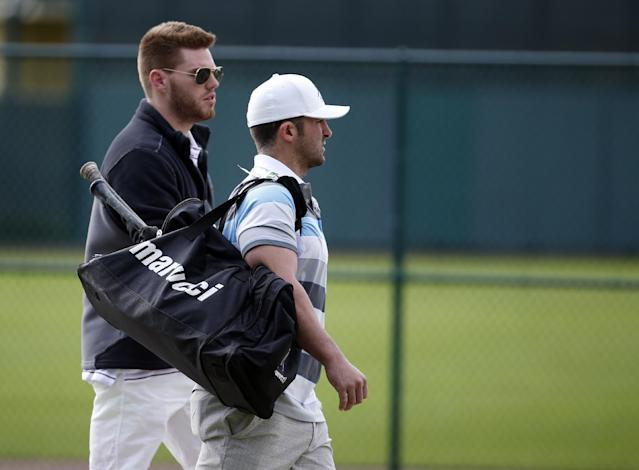 Atlanta Braves first baseman Freddie Freeman, left, and second baseman Dan Uggla arrive for a spring training baseball workout, Thursday, Feb. 13, 2014, in Kissimmee, Fla. (AP Photo/Alex Brandon)