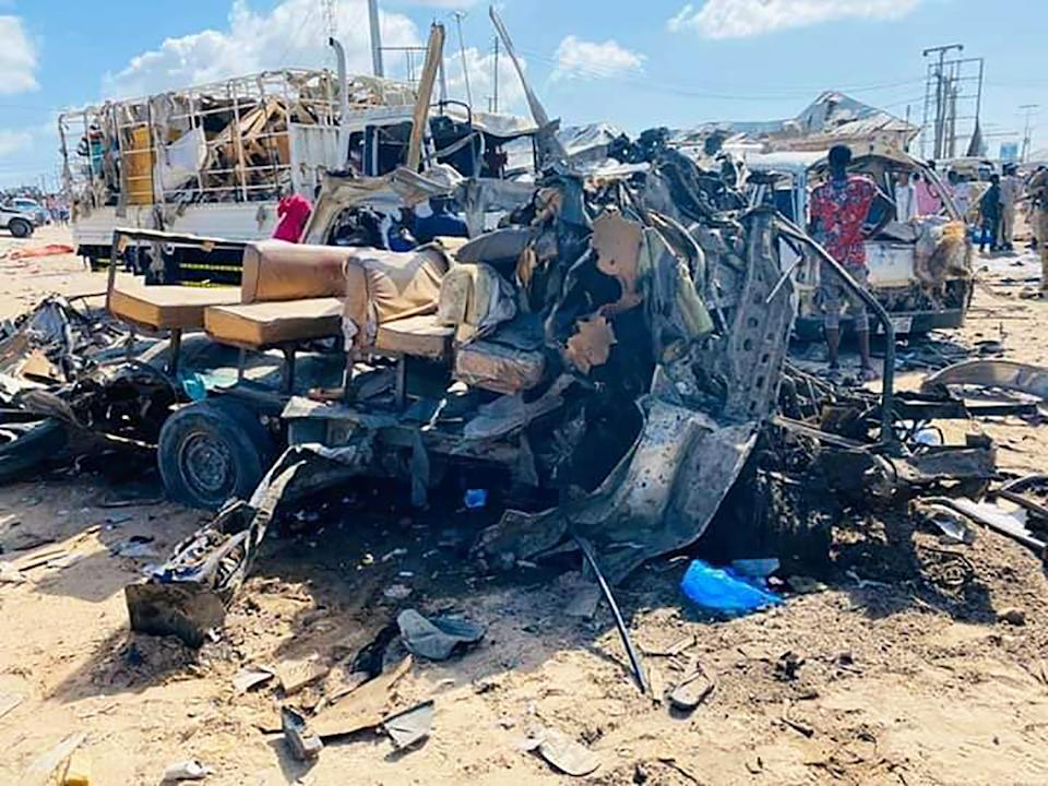 28 December 2019, Somalia, Mogadishu: The wreckage of a bus stands on the road at a checkpoint after a car bomb attack. (Best possible picture quality) At least 18 people were killed in a car bomb attack in Somalia's capital Mogadishu on Saturday, according to police. Photo: Abdirahman Mohamed/dpa (Photo by Abdirahman Mohamed/picture alliance via Getty Images)